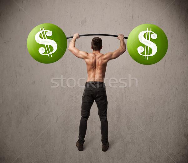 Gespierd man groene dollarteken gewichten Stockfoto © ra2studio