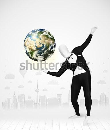 Uomo suit pianeta terra divertente Foto d'archivio © ra2studio
