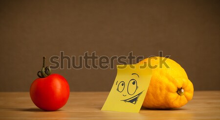 Stock photo: Lemon with post-it note looking curiously at apples