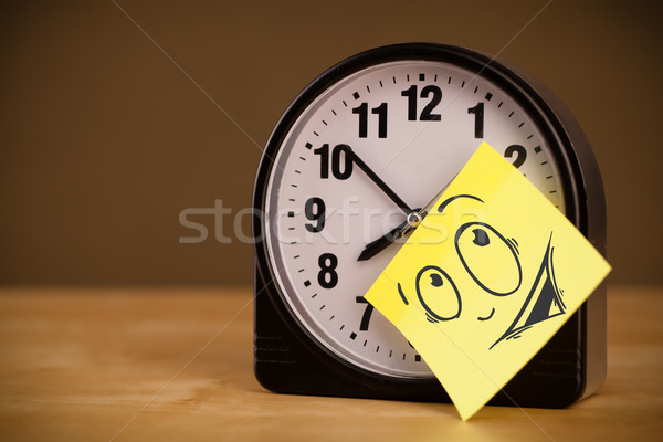 Post-it note with smiley face sticked on a clock Stock photo © ra2studio