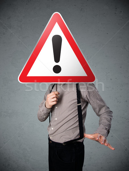 Businessman holding an exclamation road sign Stock photo © ra2studio