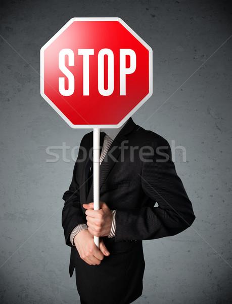 бизнесмен знак остановки Постоянный голову стороны Сток-фото © ra2studio