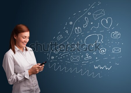 Girl typing on smartphone with various modern technology icons Stock photo © ra2studio