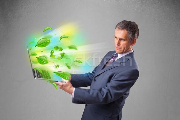 Empresario portátil reciclar ambiental guapo Foto stock © ra2studio