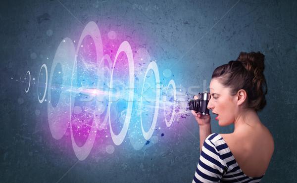 Fotós lány készít fotók erőteljes fény Stock fotó © ra2studio
