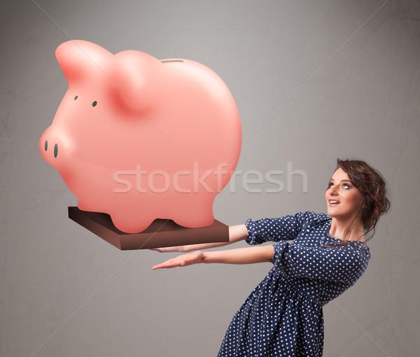 Jovem enorme poupança piggy bank belo Foto stock © ra2studio