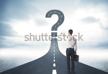 Businessman on rock mountain with a question mark Stock photo © ra2studio