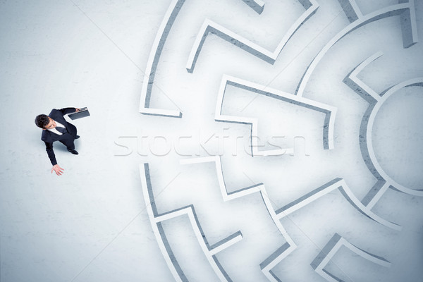 Business man looking at circular maze with nowhere to go Stock photo © ra2studio