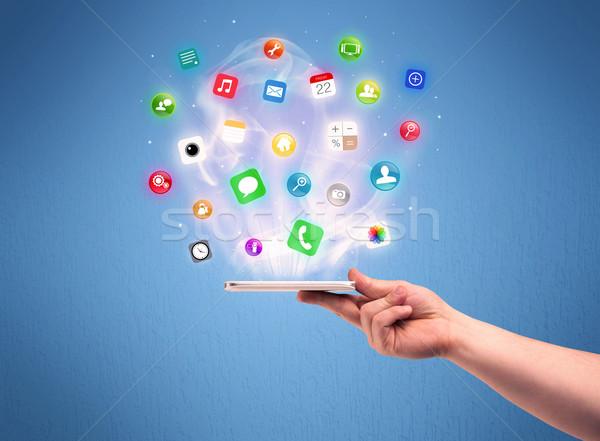 Mano tablet telefono app icone Foto d'archivio © ra2studio