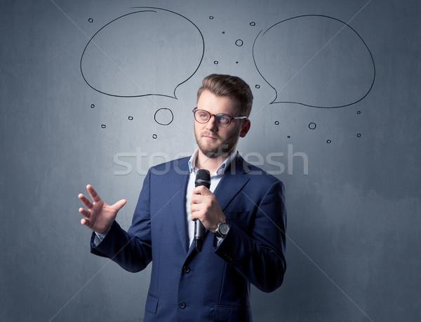 üzletember tart mikrofon beszél szövegbuborékok fej Stock fotó © ra2studio
