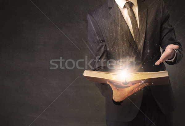Man holding a book. Stock photo © ra2studio