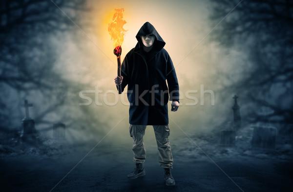 Férfi ki égő néz valami fény Stock fotó © ra2studio