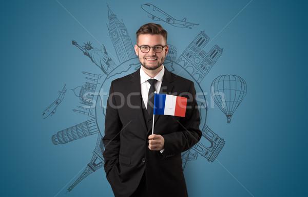 Elegáns férfi városnézés zászló kéz épület Stock fotó © ra2studio