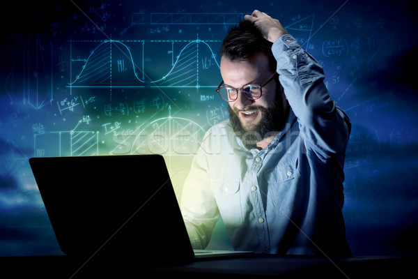 Stock photo: Businessman in the office at night