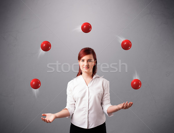 Jong meisje permanente jongleren Rood mooie Stockfoto © ra2studio