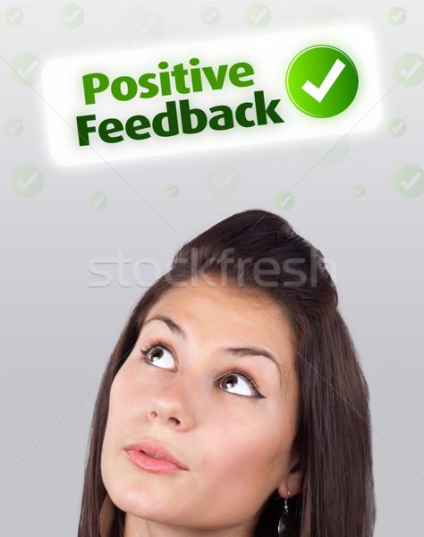 Jeune fille regarder positif négatifs signes tête Photo stock © ra2studio