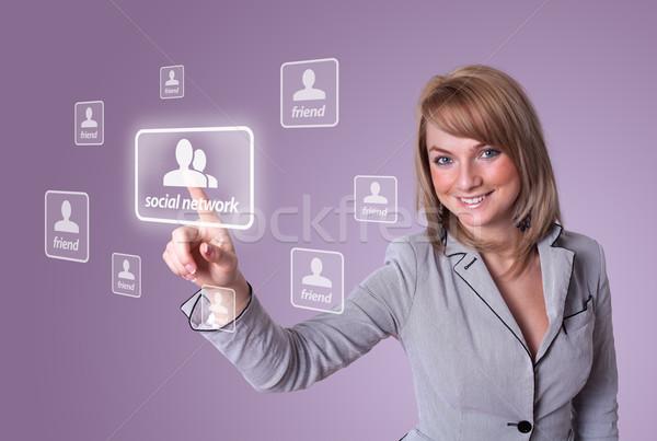 woman hand pressing Social Network icon Stock photo © ra2studio