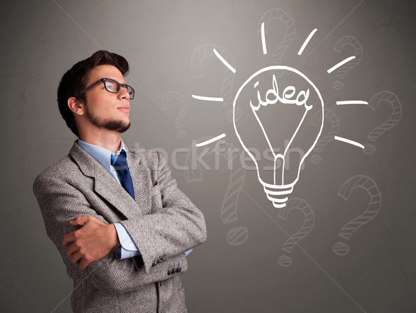 Young boy comming up with a light bulb idea sign Stock photo © ra2studio