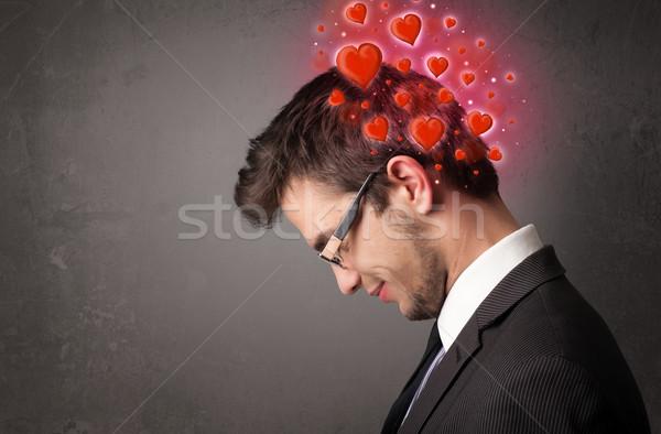 Giovani persona pensare amore rosso cuori Foto d'archivio © ra2studio