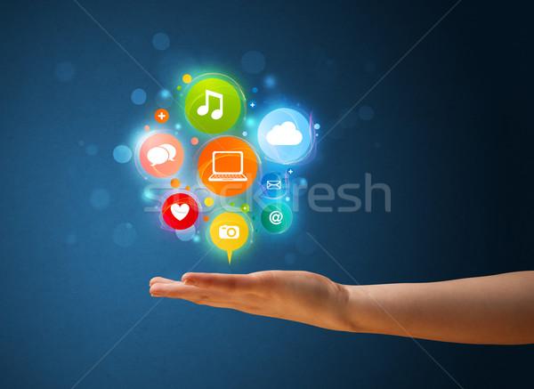 Multimédia ikonok kéz nő fiatal nő tart Stock fotó © ra2studio