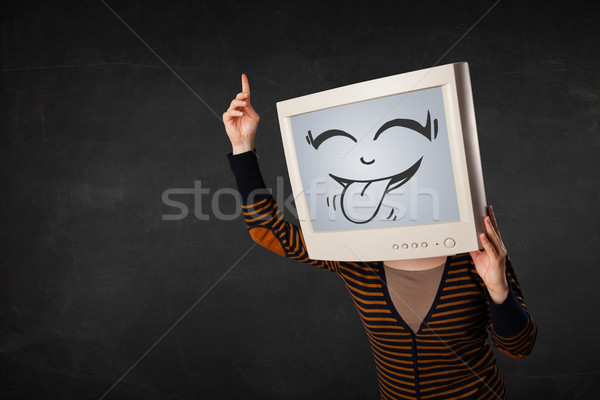 Young girl wearing a monitor with a funny face Stock photo © ra2studio