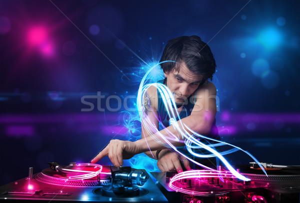 диск-жокей играет музыку световыми эффектами фары молодые Сток-фото © ra2studio