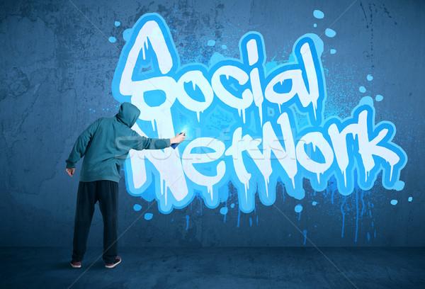 Young urban painter drawing Stock photo © ra2studio