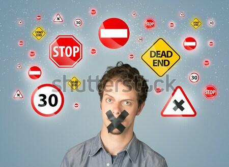 Young man with glued mouth and traffic signals Stock photo © ra2studio