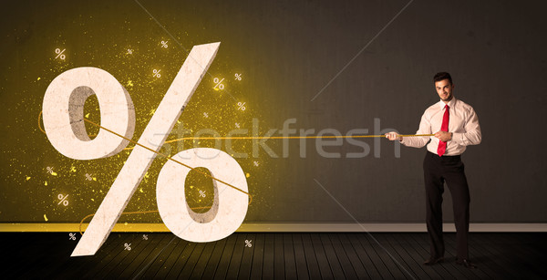 Business man pulling rope with big procent symbol sign  Stock photo © ra2studio