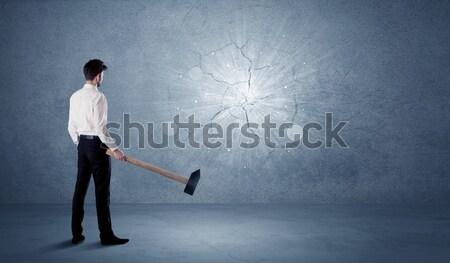 Homme d'affaires mur marteau bureau pierre Photo stock © ra2studio