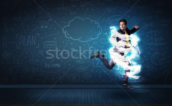 Feliz hombre de negocios saltar tormenta nube alrededor Foto stock © ra2studio