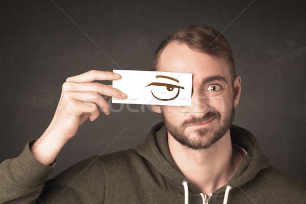 Jonge persoon papier boos oog Stockfoto © ra2studio