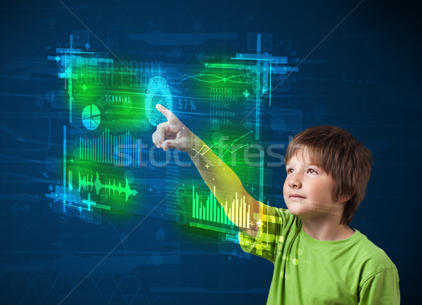Modern young boy pressing modern technology panel with finger pr Stock photo © ra2studio