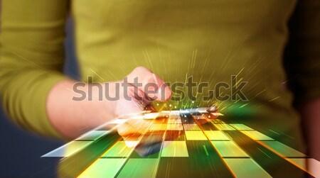 Nő tart okostelefon futurisztikus vonalak absztrakt Stock fotó © ra2studio