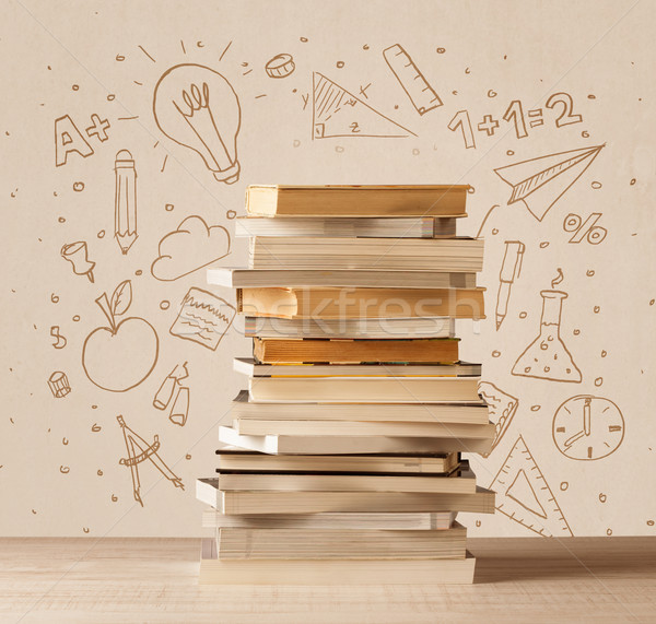 A pile of books on table with school hand drawn doodle sketches Stock photo © ra2studio