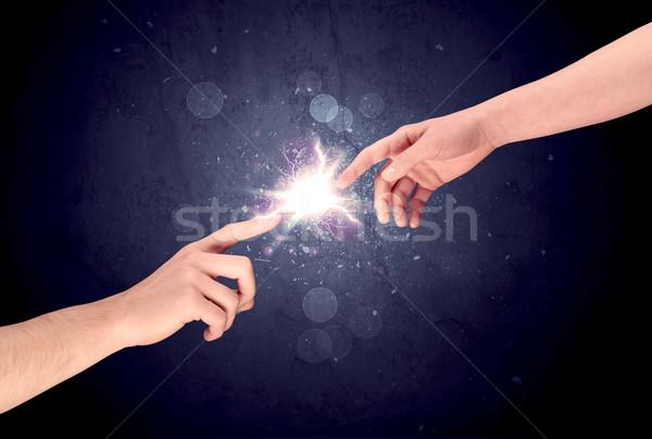 Eller ışık kıvılcım iki erkek diğer Stok fotoğraf © ra2studio