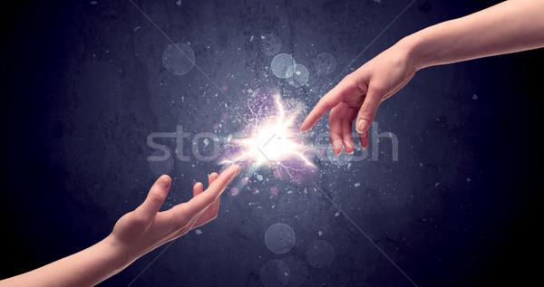 рук свет искрить два мужчины другой Сток-фото © ra2studio
