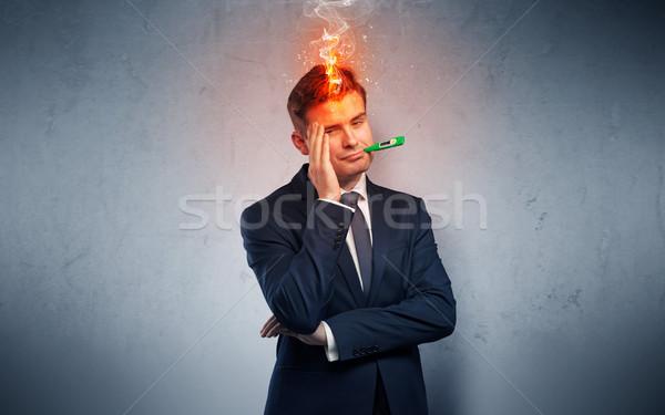 Sick businessman with burning head concept Stock photo © ra2studio