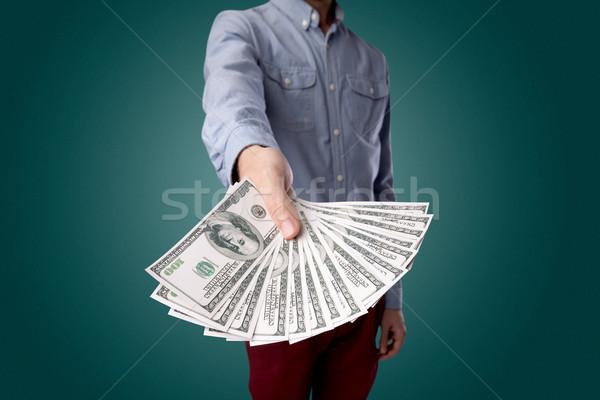 Işadamı para genç büyük miktar Stok fotoğraf © ra2studio
