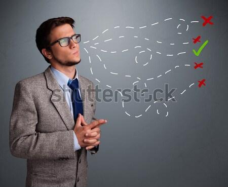 Young man choosing between right and wrong sings Stock photo © ra2studio