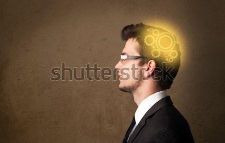 Atrakcyjny młody człowiek stałego myślenia kopia przestrzeń uśmiech Zdjęcia stock © ra2studio
