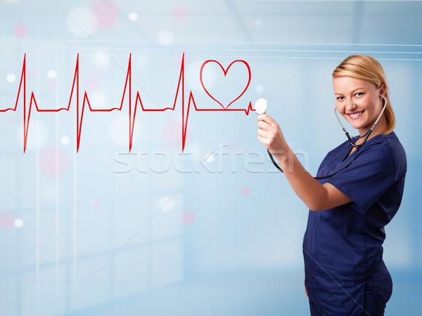 Fiatal nővér hallgat absztrakt pulzus piros Stock fotó © ra2studio