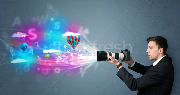 Handsome photographer with camera and abstract imaginary Stock photo © ra2studio