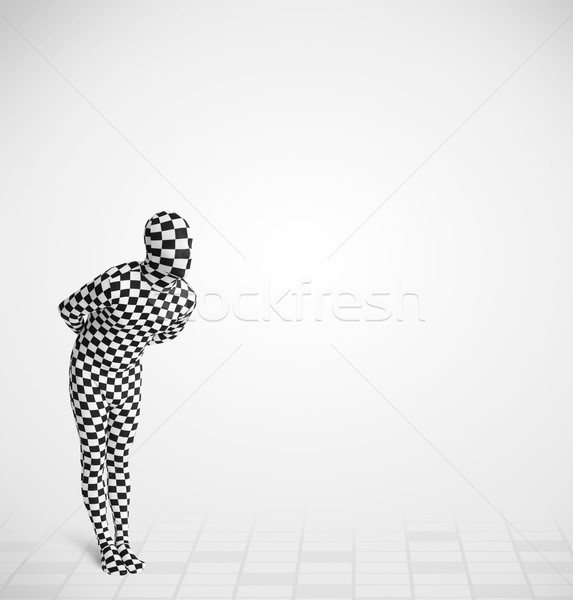 Funny guy in morphsuit body suit looking at copy space Stock photo © ra2studio