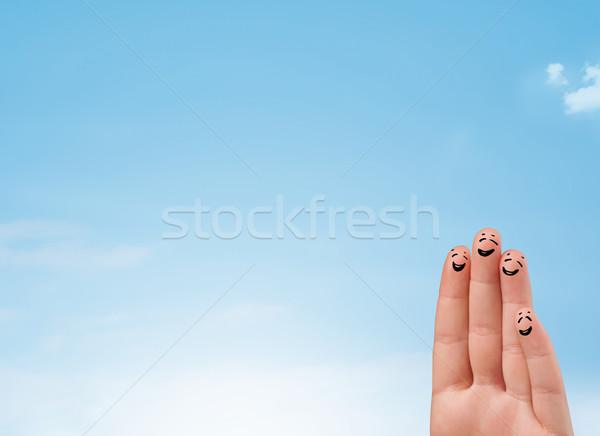 Felice dita guardando cielo blu copia spazio Foto d'archivio © ra2studio
