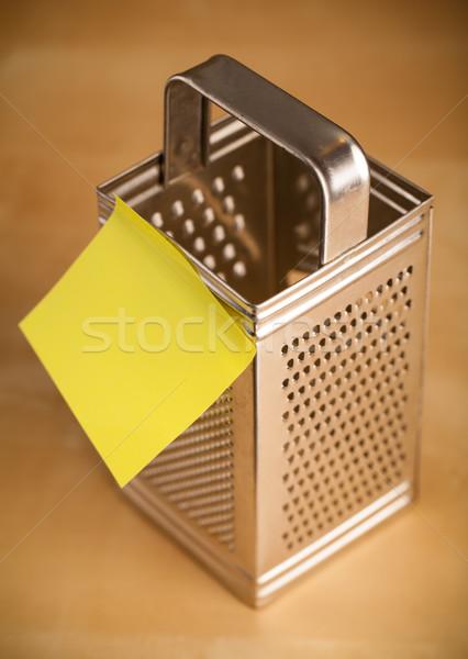 Empty post-it note sticked on grater Stock photo © ra2studio