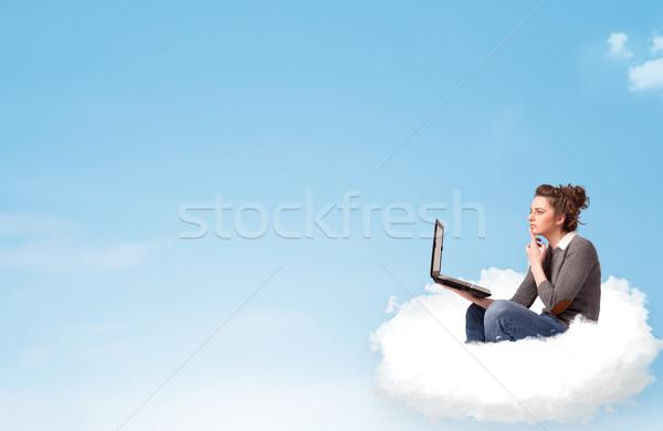 Fiatal nő laptop ül felhő copy space csinos Stock fotó © ra2studio