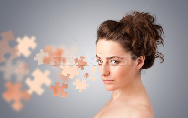 Pretty young girl with skin puzzle illustration Stock photo © ra2studio