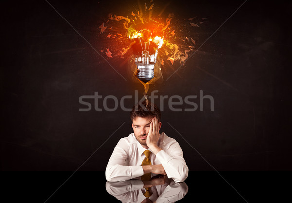 Imprenditore seduta idea lampadina depresso Foto d'archivio © ra2studio