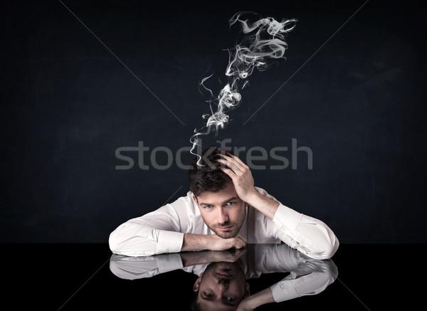 Depressed businessman with smoking head Stock photo © ra2studio